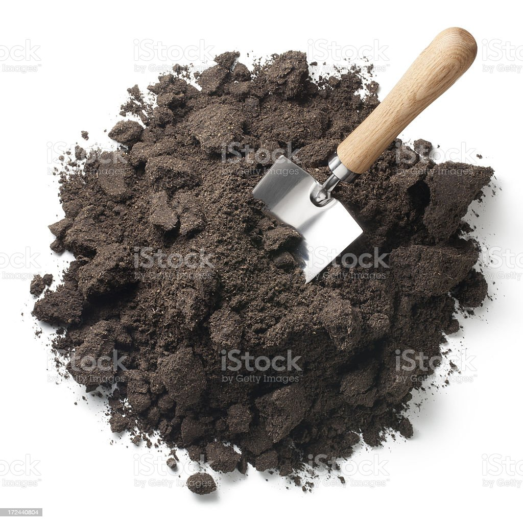 Pile of soil with a garden trowel royalty-free stock photo