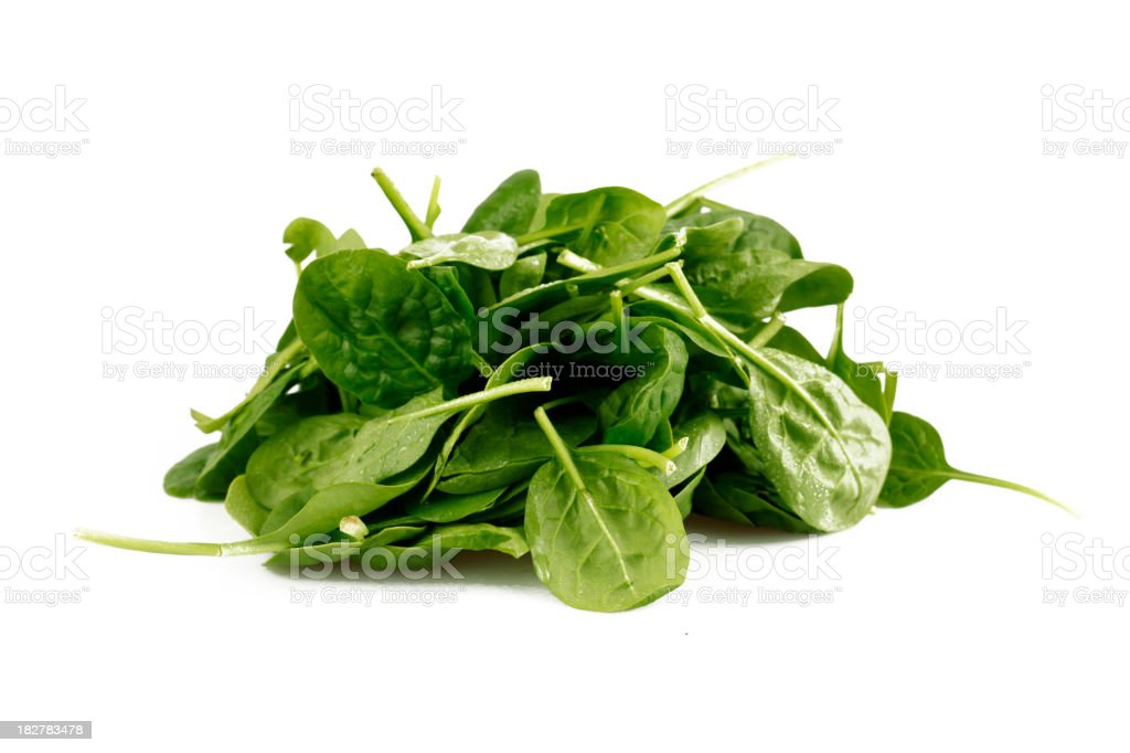 Pile of spinach leaves on a white background stock photo