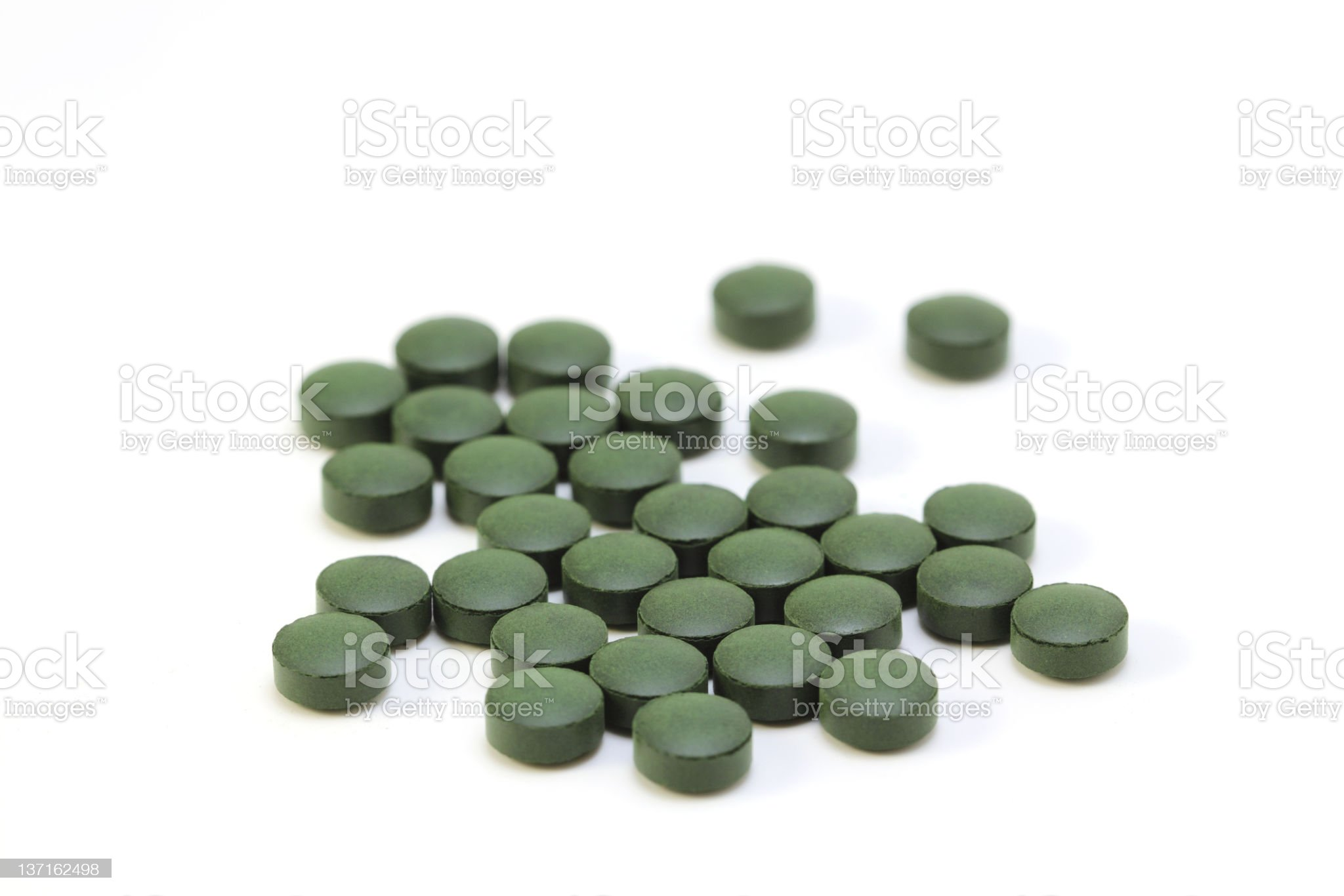 Pile of spirulina tablets royalty-free stock photo
