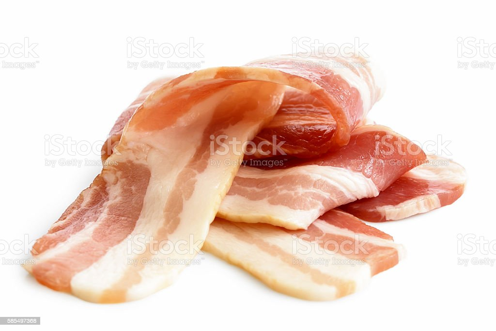Pile of streaky uncooked bacon isolated on white. stock photo