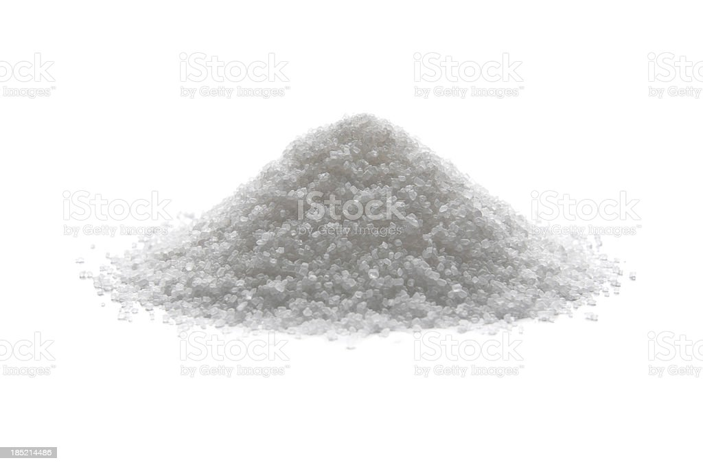 Pile of sugar isolated on white stock photo