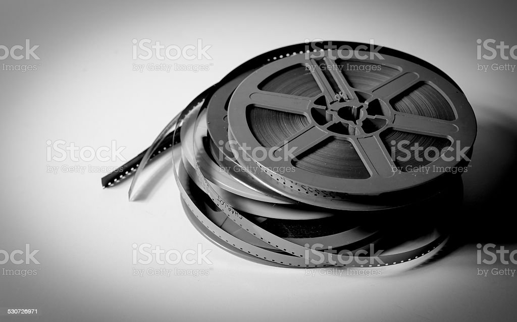 Pile of super8 movie reels in black and white stock photo