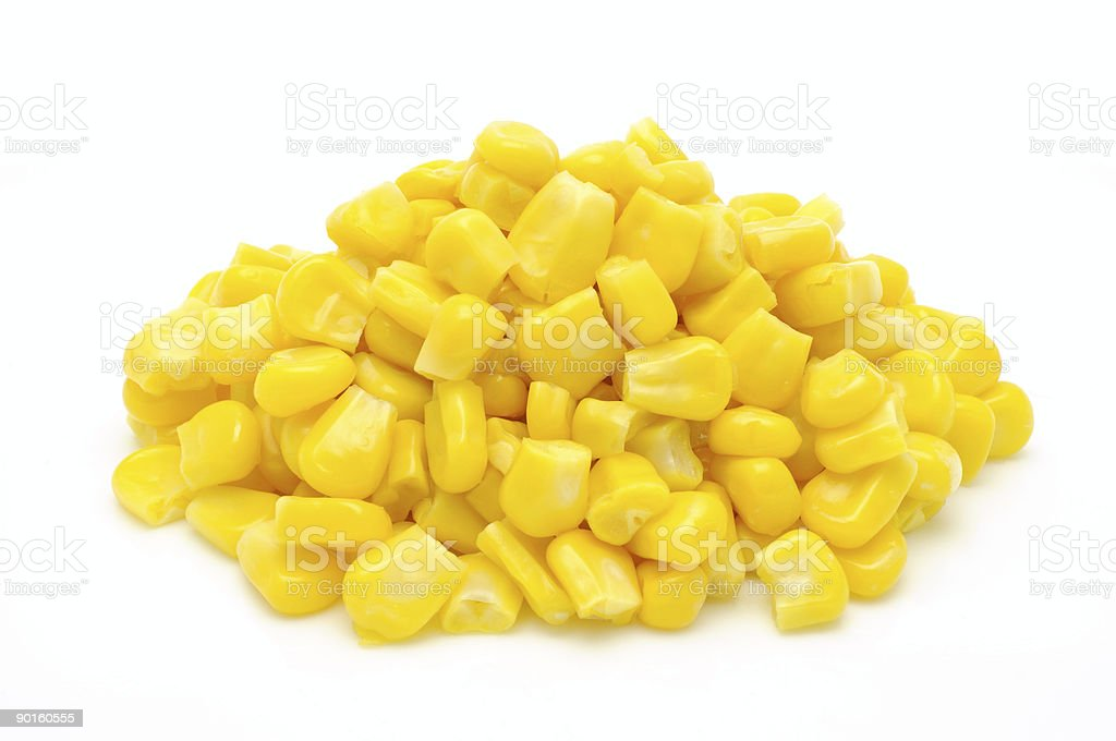 Pile of sweet corn kernels isolated on white stock photo