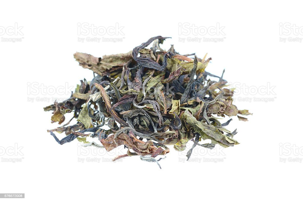 pile of tea leaves isolated on white stock photo