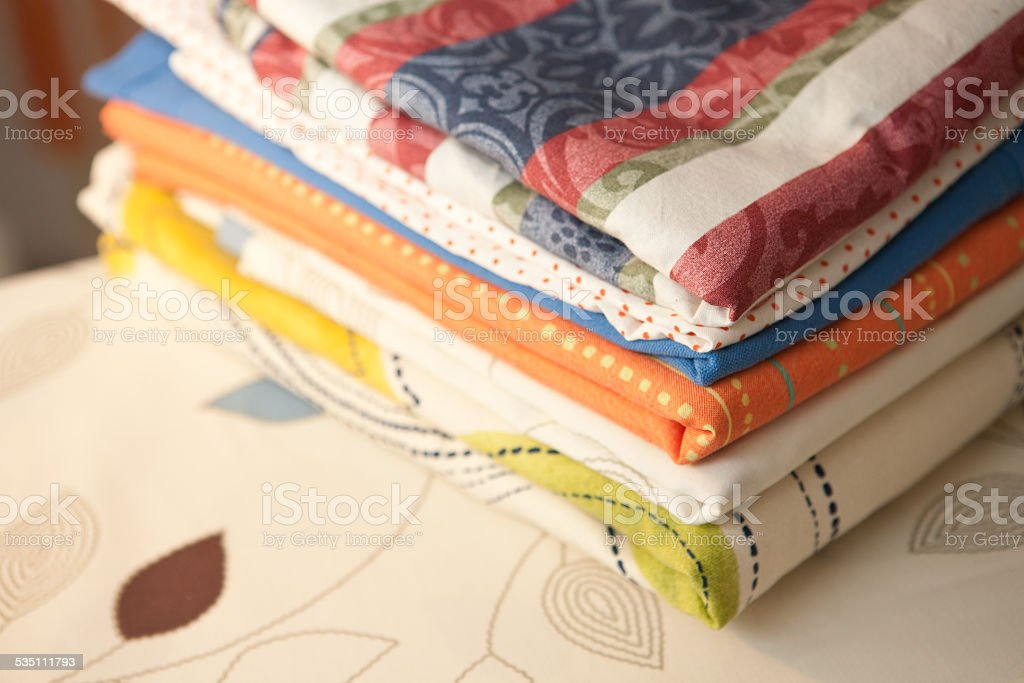 Pile of the washed and ironed linen stock photo
