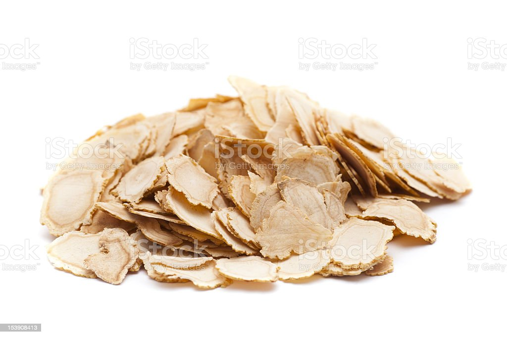 Pile of thinly sliced ginseng on a white background stock photo