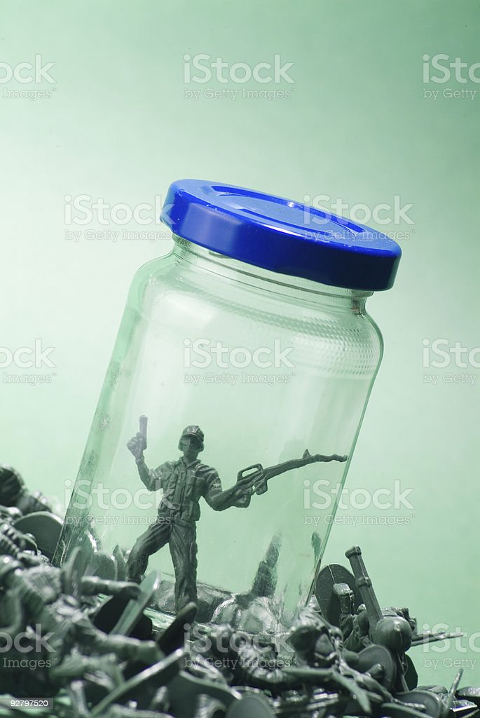 Pile of toy soldiers, one in jar royalty-free stock photo