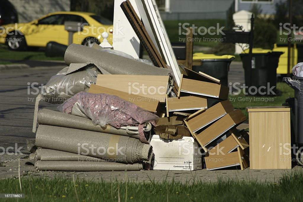 A pile of trash sitting on a curb stock photo