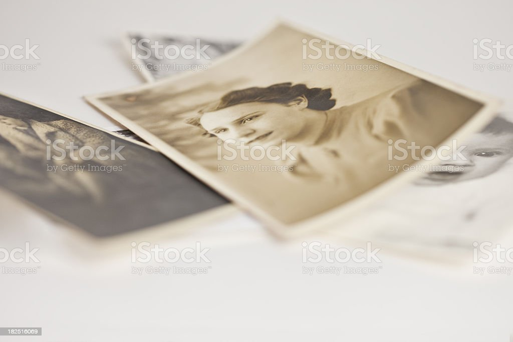 pile of treasured old family photographs stock photo