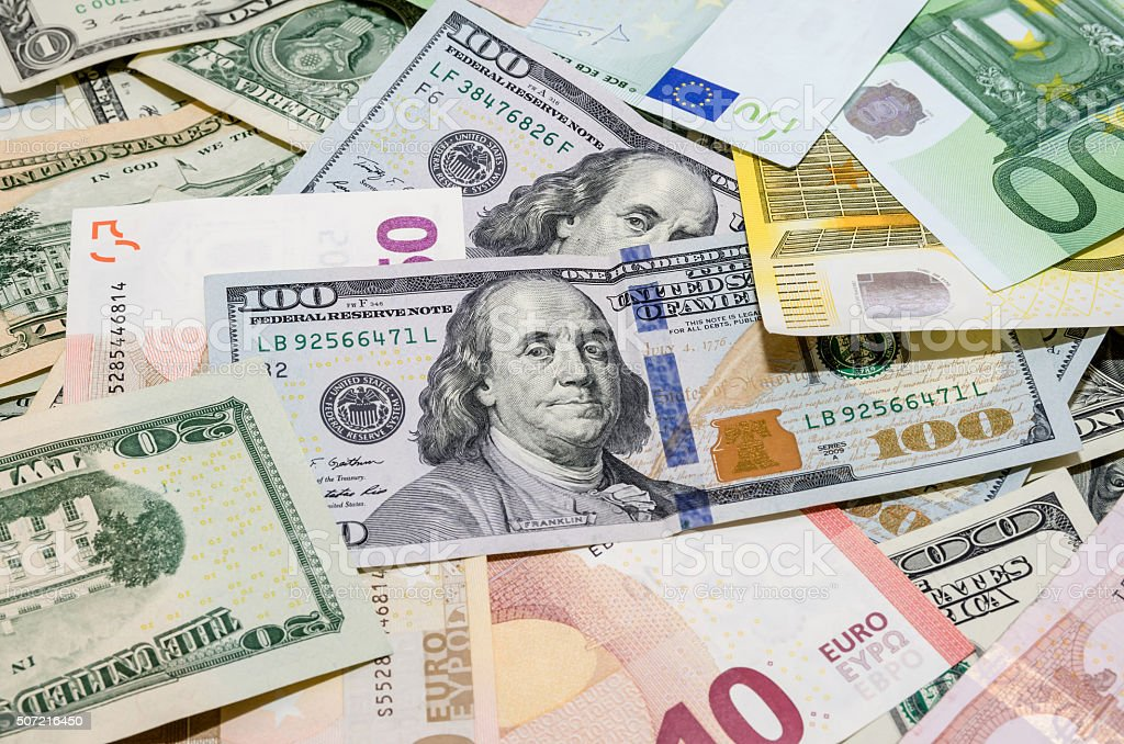 Pile of two leading currencies US Dollar versus Euro. background stock photo