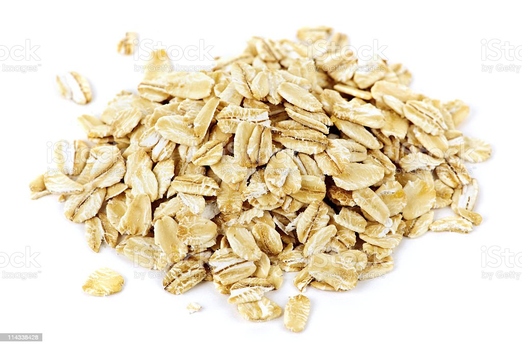 Pile of uncooked rolled oats stock photo