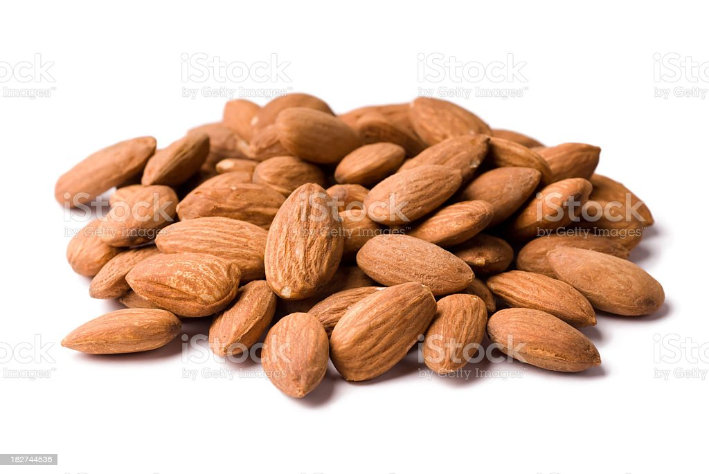 A pile of unpeeled almonds on a white background stock photo