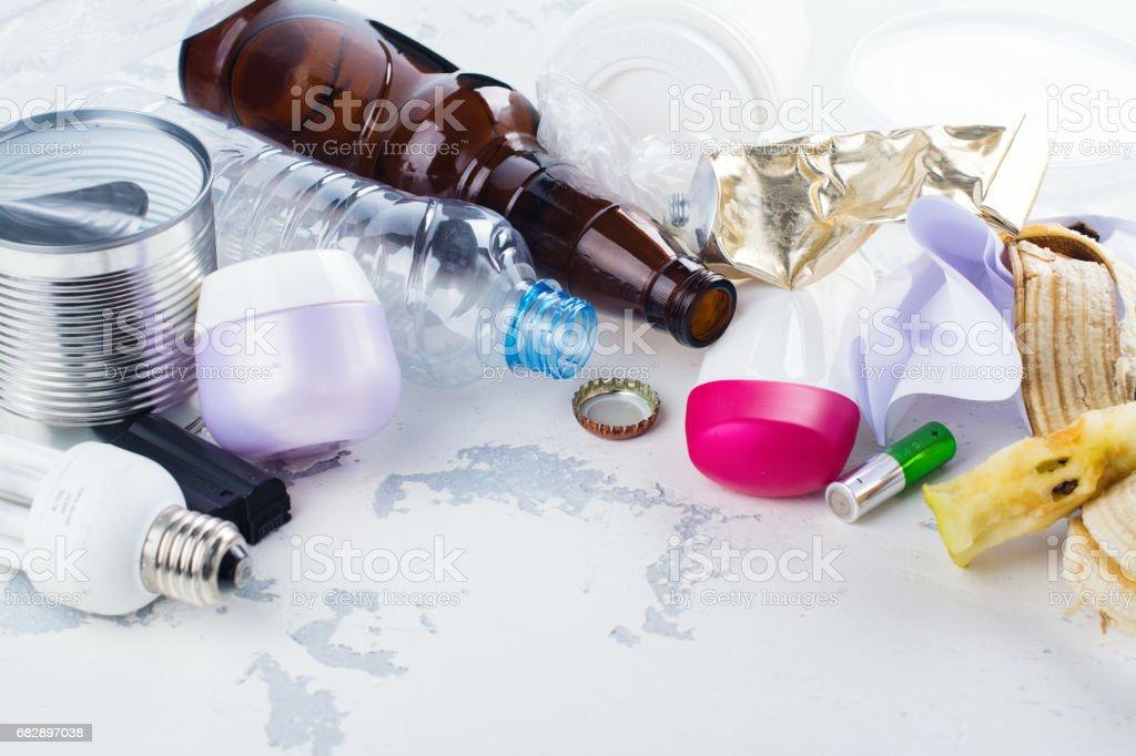 Pile of unsorted waste on white stone background stock photo