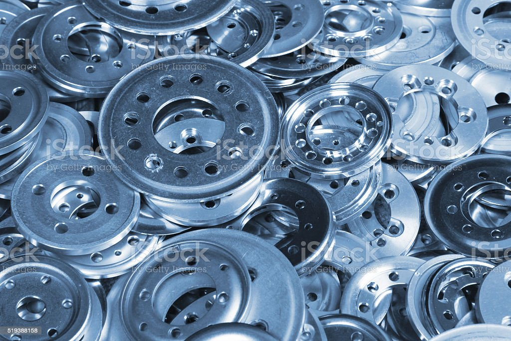 Pile of variety blue aluminum spacers and washers stock photo