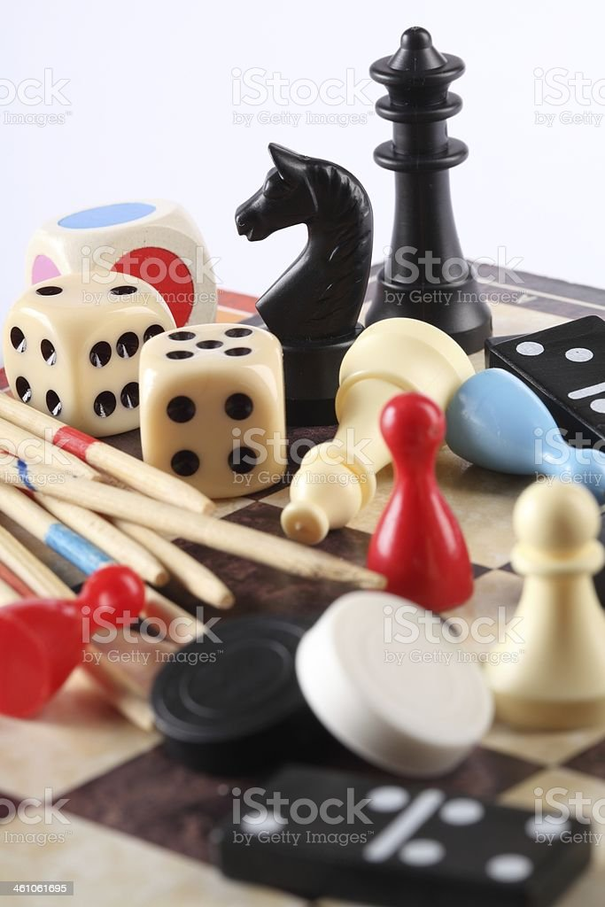 Pile of various board game pieces stock photo