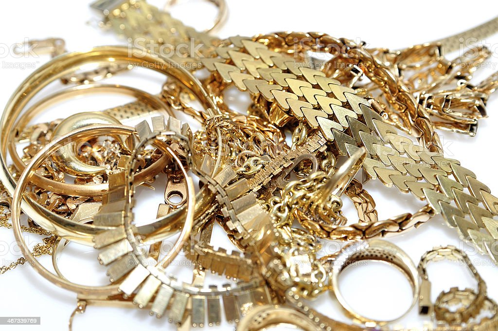 A pile of various pieces of gold jewelry stock photo