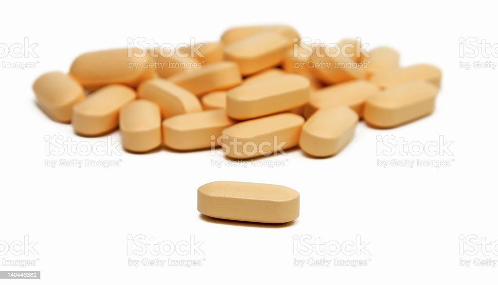 A pile of vitamins on white back drop royalty-free stock photo