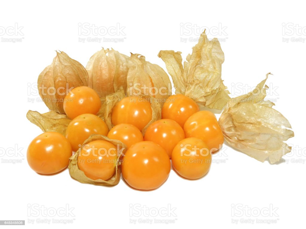 Pile of vivid yellow ripe Cape gooseberries with calyx stock photo