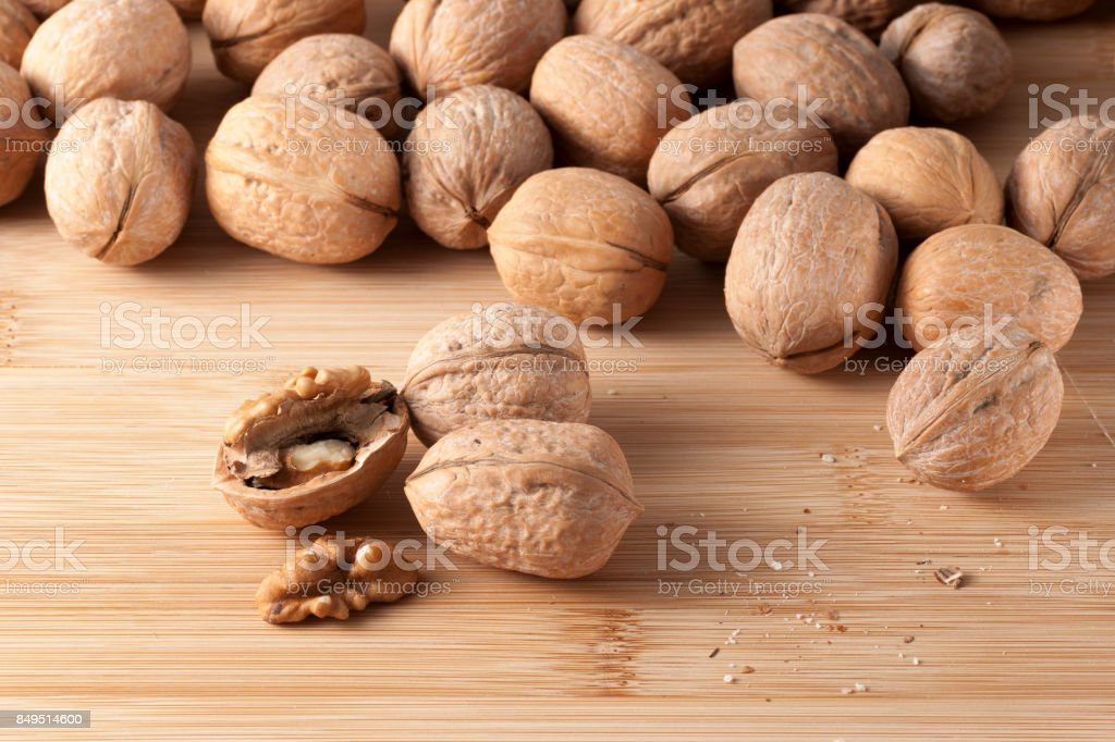 pile of walnuts in the foreground represent a healthy diet stock photo