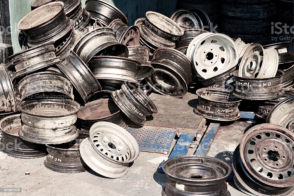 Pile of Wheels and Hubcaps - Bronx, NY 'Chop Shop' royalty-free stock photo