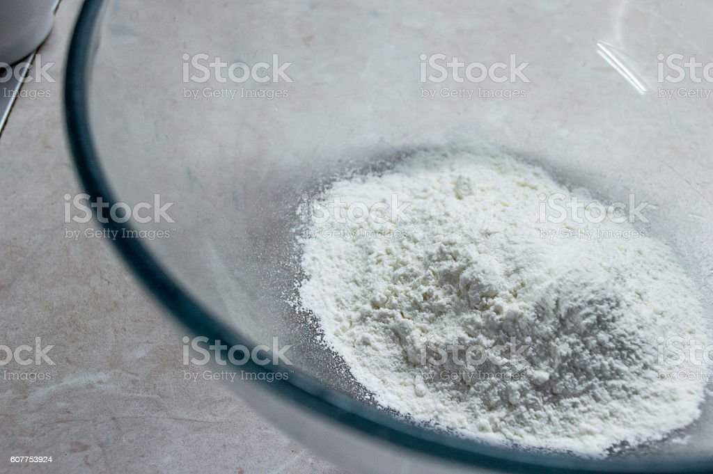 Pile of White Flour in a Glass Bowl royalty-free stock photo