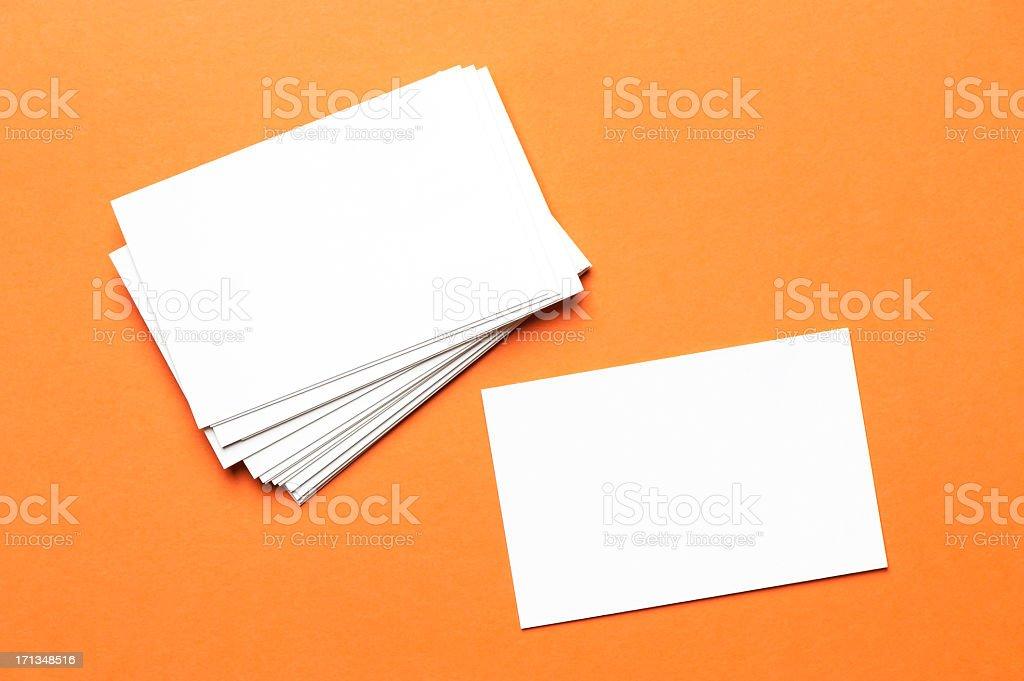 Pile of white notecards on an orange background stock photo