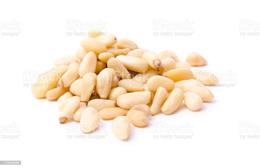 Pile of white pine nuts on a white background stock photo