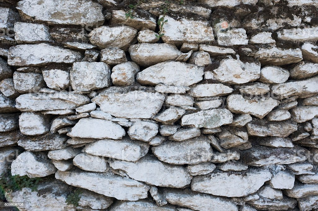 Pile of white stone wall texture stock photo