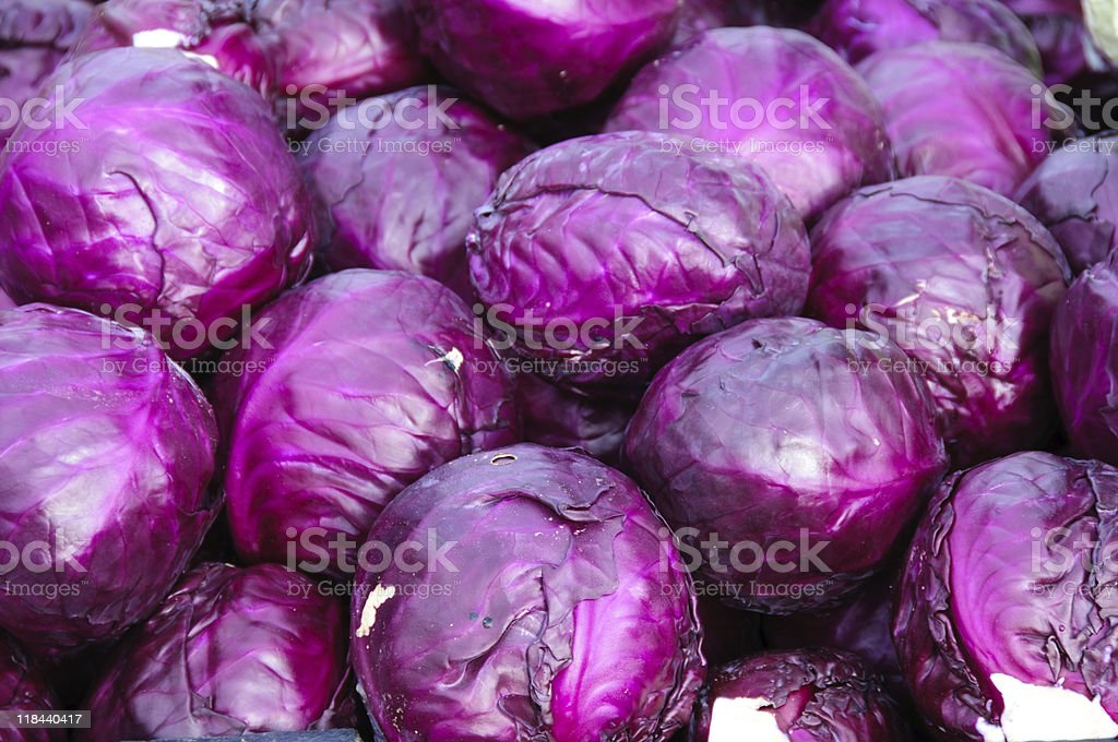 Pile of whole bright purple cabbages stock photo