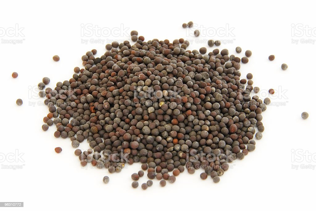 Pile of whole brown mustard seeds on white royalty-free stock photo