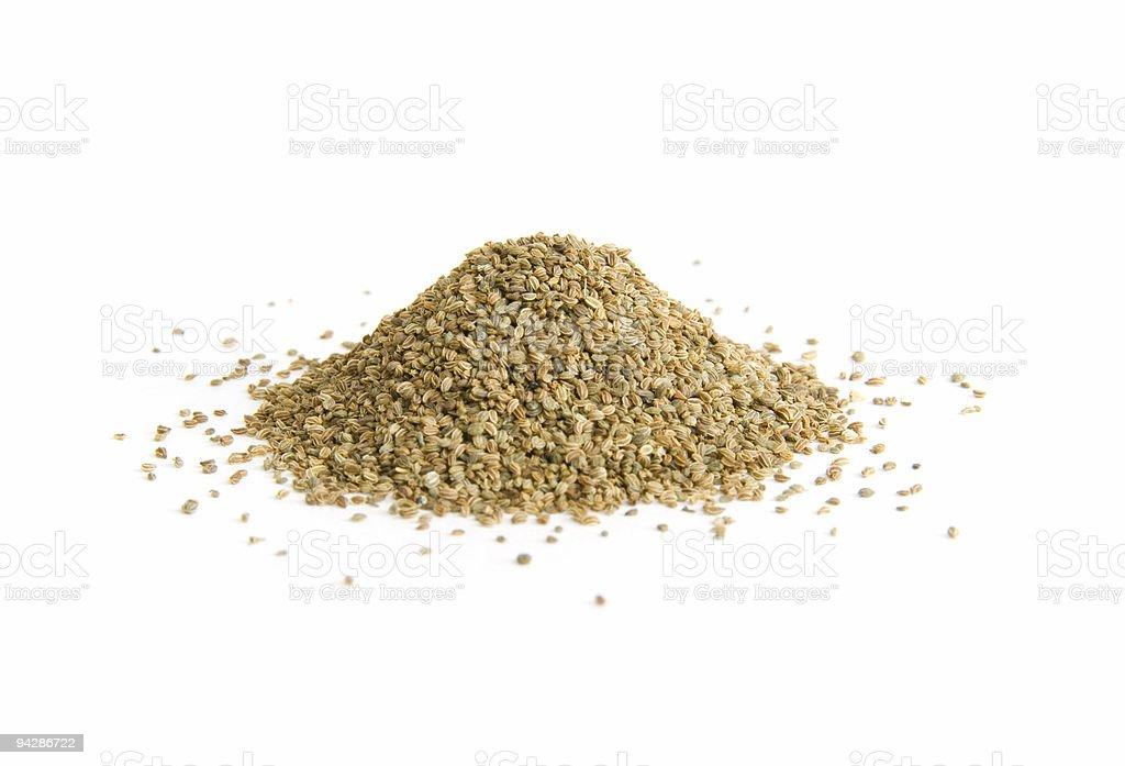 Pile of whole celery seeds on white stock photo