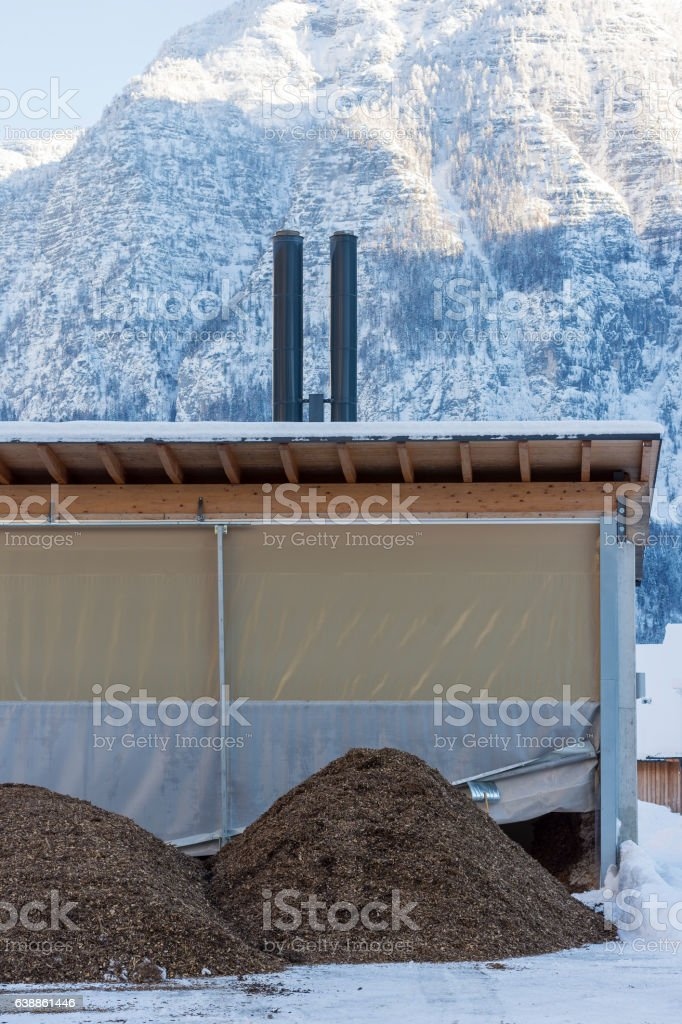 Pile of Wood Chip Biofuel and Small Heating Power Plant stock photo