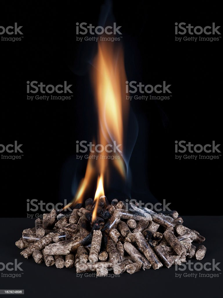 Pile of wood pellets burning royalty-free stock photo