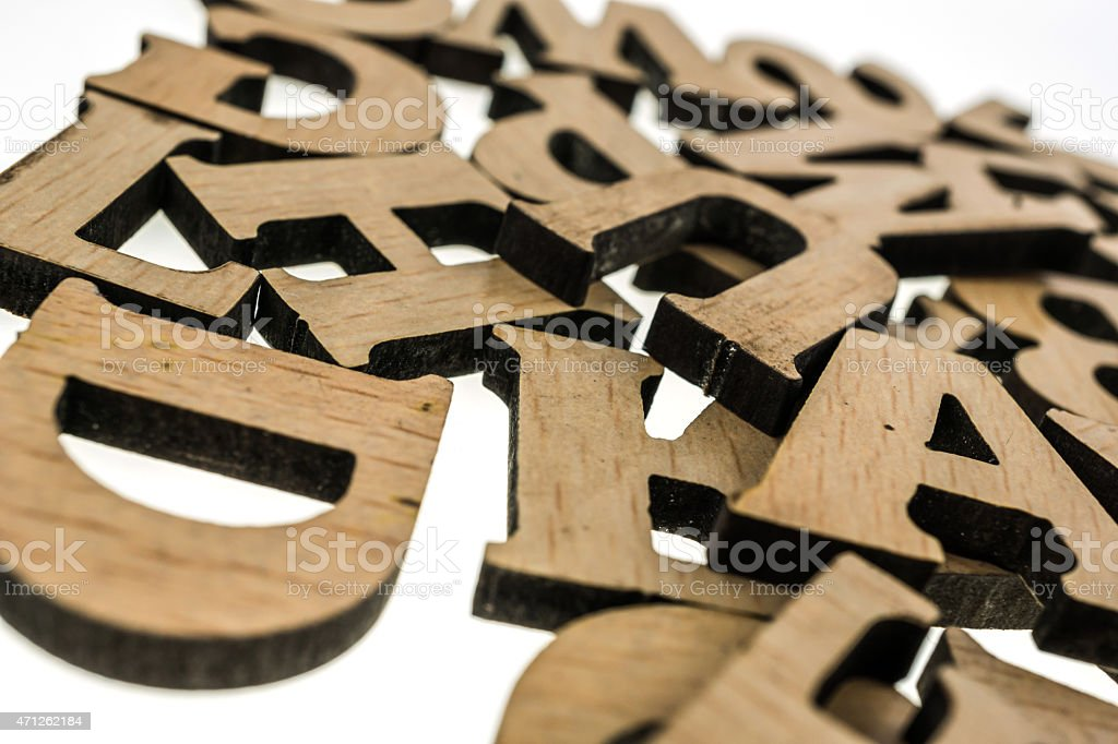 Pile of wooden block letters isolated on white stock photo