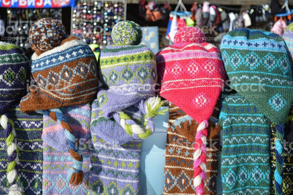 Pile of woolen caps stock photo