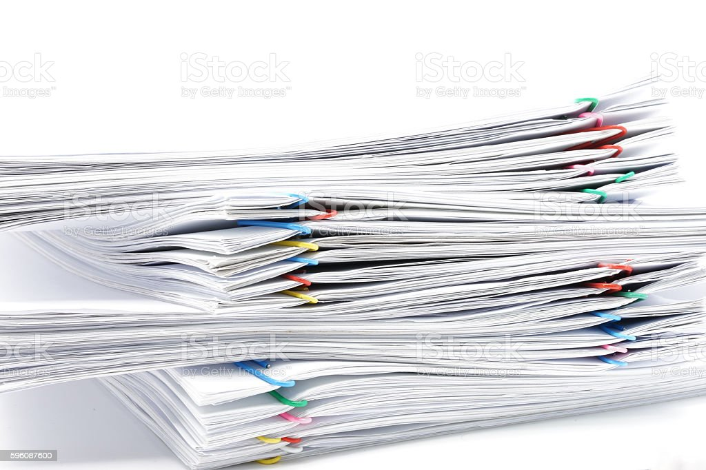 Pile of workload paperwork on white background royalty-free stock photo