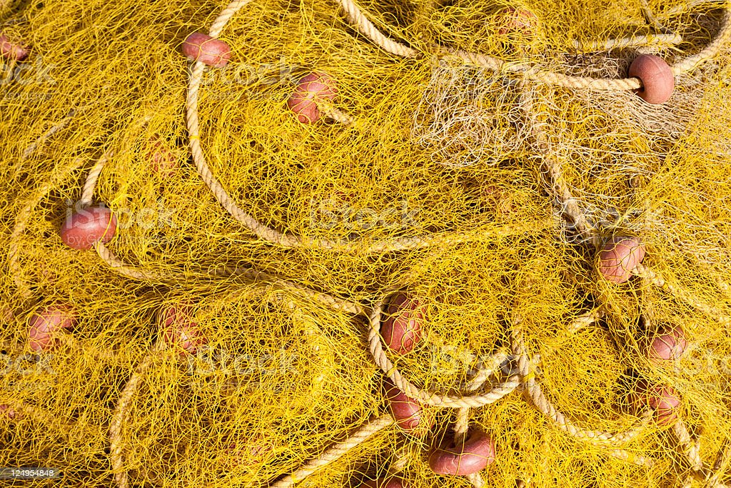 Pile of yellow fishing nets royalty-free stock photo