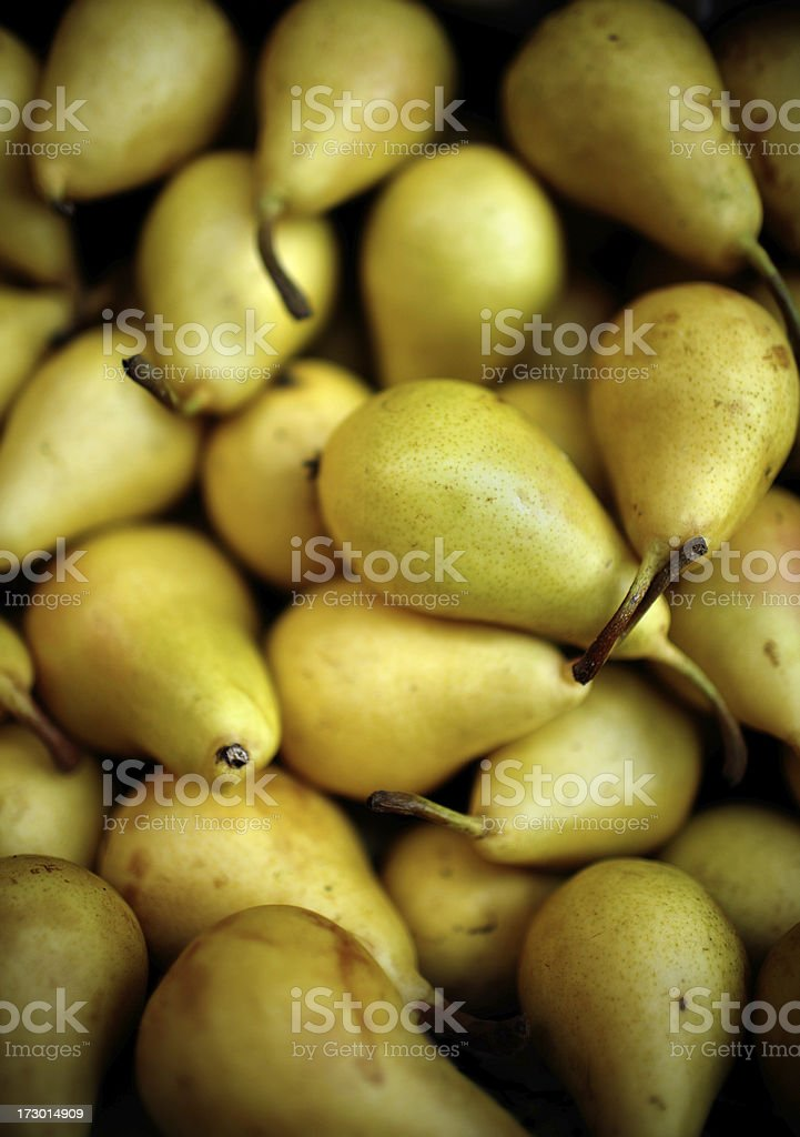 A pile of yellow small ripe pears royalty-free stock photo