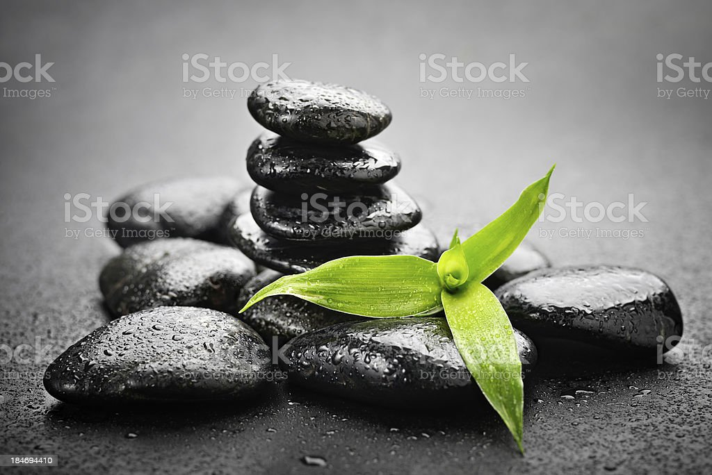 A pile of Zen stones on a black stone background royalty-free stock photo