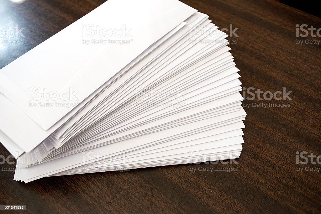 Pile white letter office on wood table stock photo