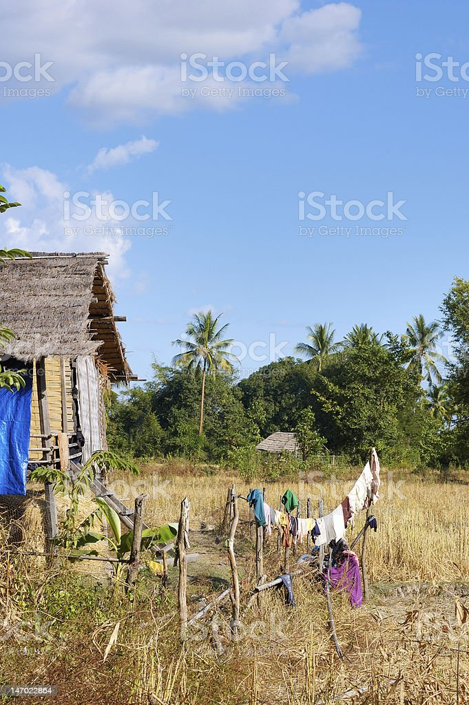 Pile-building in Laos. Dress dry no the fence stock photo