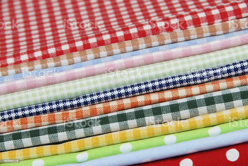 Piled fabrics with gingham pattern and polka dots royalty-free stock photo