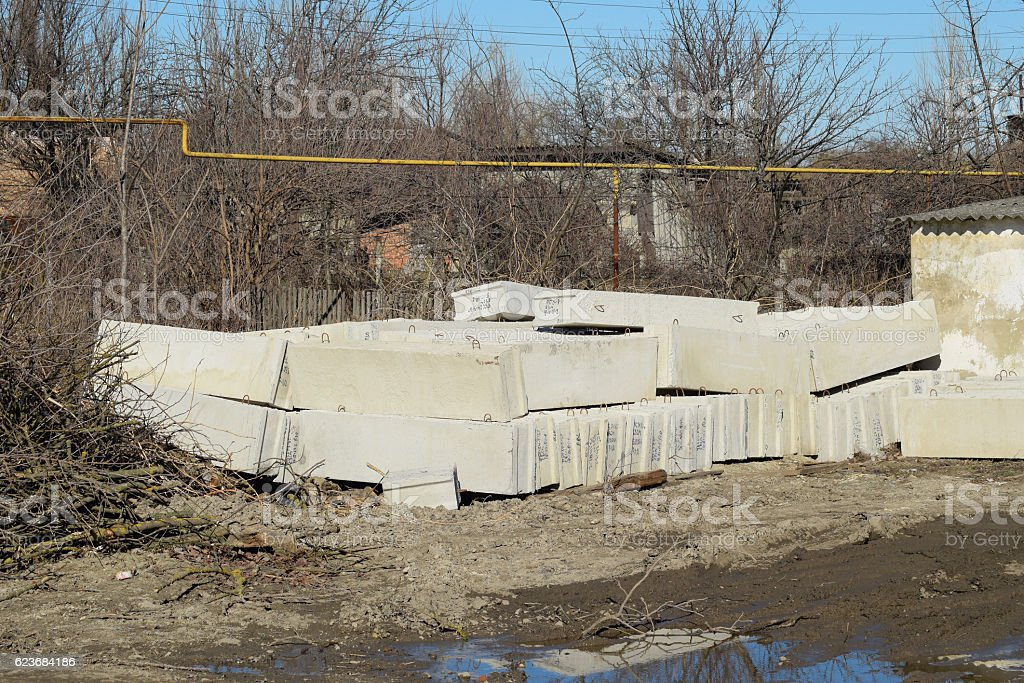 Piled in a heap of concrete blocks. stock photo
