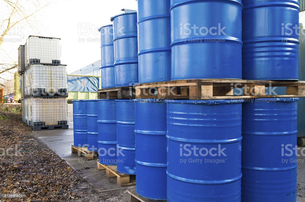 piled up oil barrels stock photo