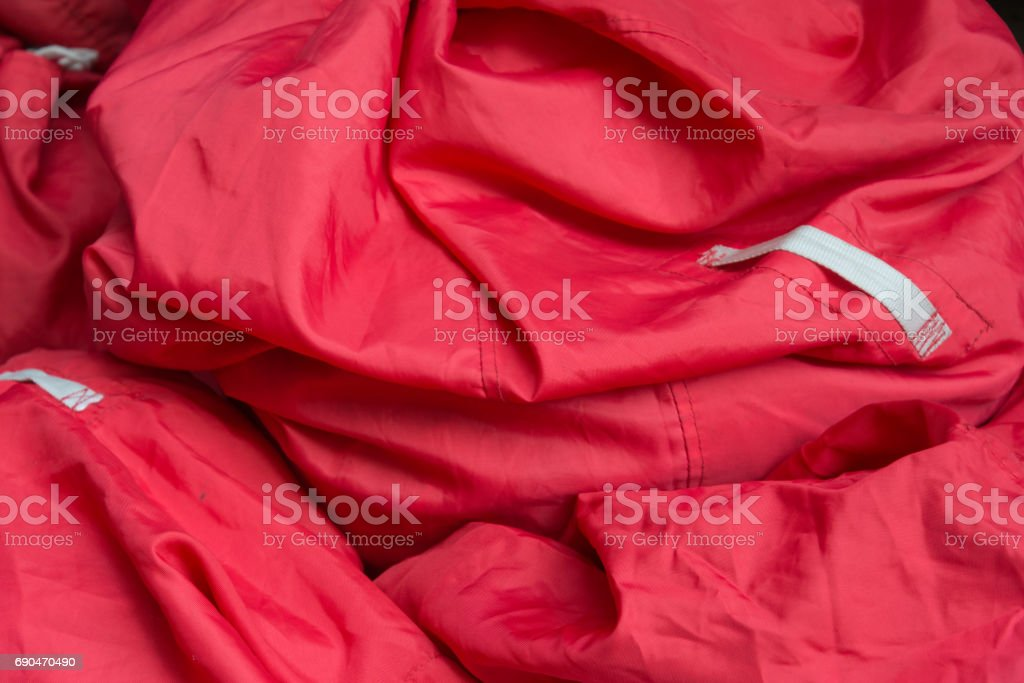 Piled up stack of red bags stock photo