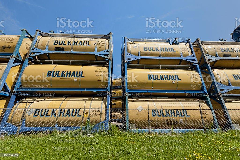 piled up storage tanks for bulk transportation stock photo