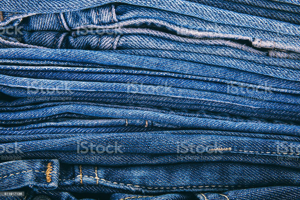 Piled-up blue jeans stock photo