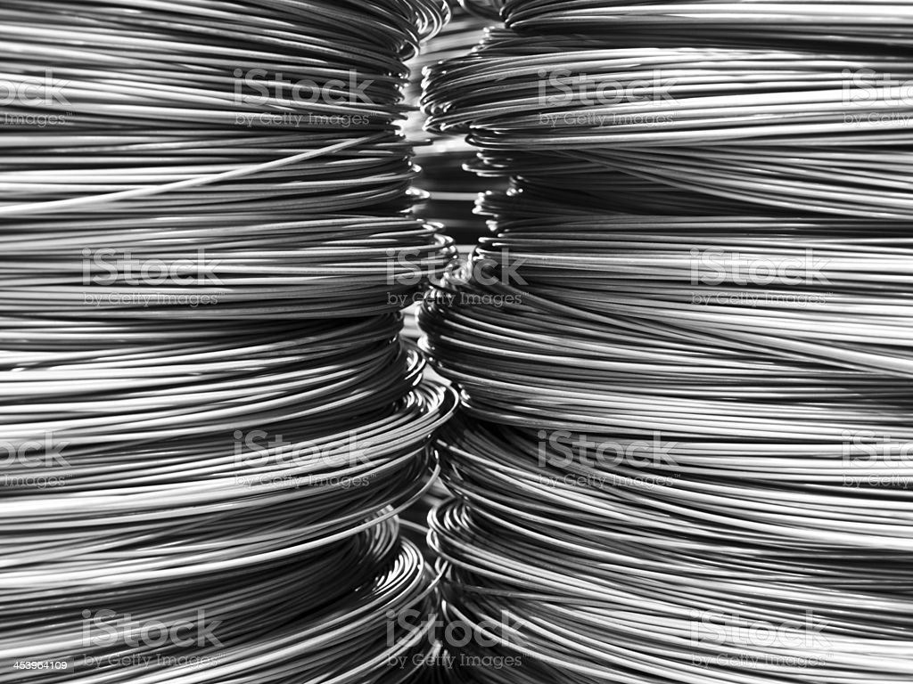 Piles and piles of steel wire occupying the whole photo stock photo