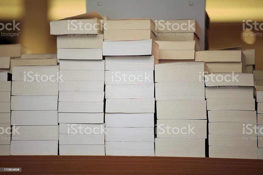 Piles of books in a bookstore royalty-free stock photo