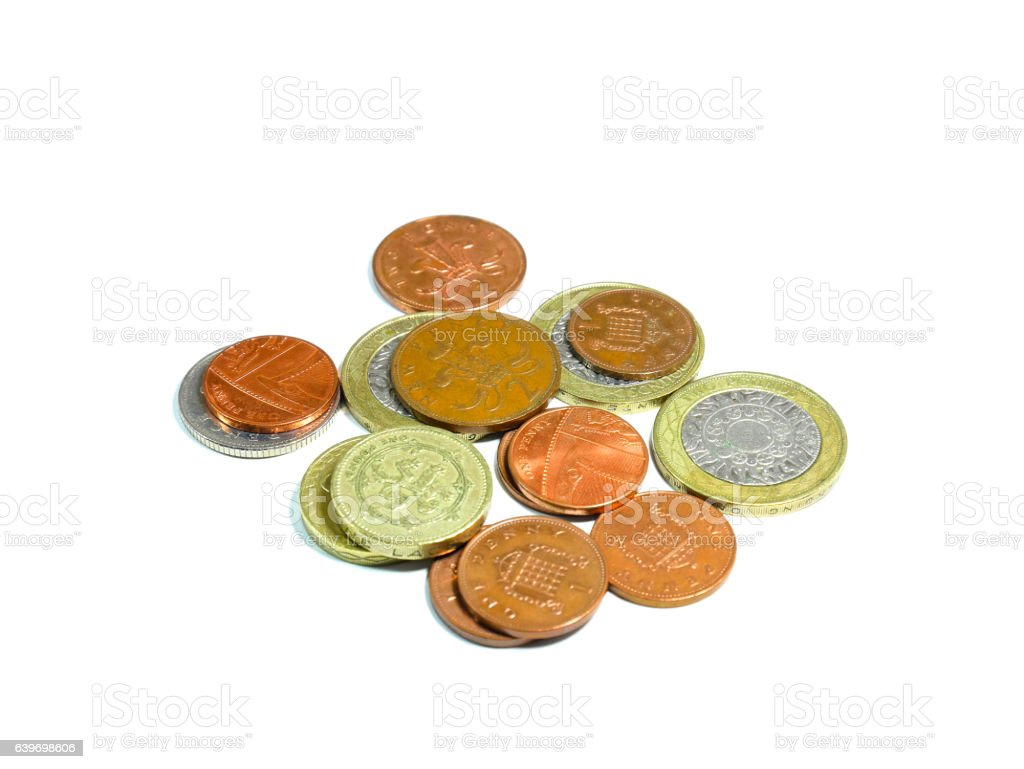 Piles of British coins isolated on white background stock photo